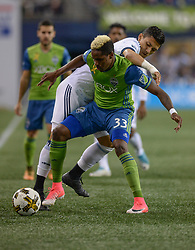September 27, 2017 - Seattle, WASHINGTON, U.S - Vancouver forward FREDY MONTERO (12) tries to get the ball from the Sounders JOEVIN JONES (33) as the Vancouver Whitecaps visit the Seattle Sounders for an MLS match at Century Link Field in Seattle, WA. (Credit Image: © Jeff Halstead via ZUMA Wire)