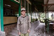 Christian Awuy outside his Vogels hostel beside Mt Merapi.