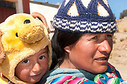 Bolivia 2013. Choritotoro. Baby Jamil wearing his teddy bear hat with mother Inez.