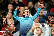 A young Swansea City fan celebrates his sides win against Everton today.<br /> Premier league match, Swansea city v Everton at the Liberty Stadium in Swansea, South Wales on Saturday 6th May 2017.<br /> pic by  Phil Rees, Andrew Orchard sports photography.
