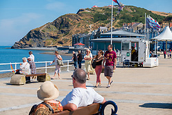 © Licensed to London News Pictures. 14/07/2018. Aberystwyth, UK. People enjoy a very warm sunny Saturday morning in Aberystwyth on the west coast of Wales. The long period of hot and unusually dry weather is continuing, with temperatures again climbing to over 30ºc in parts of the UK this weekend. photo credit: Keith Morris / LNP