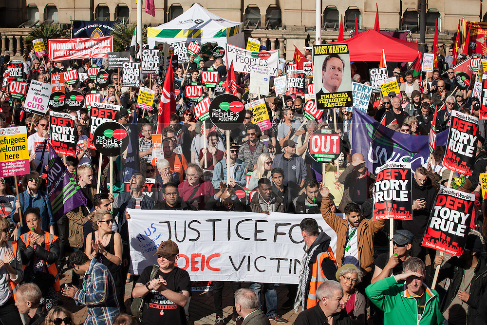 © Licensed to London News Pictures. 02/10/2016. Birmingham, UK. Protesters gather in Birmingham's Victoria Square for the People's Assembly national demonstration against the policies of Britain's Conservative government. The Conservative Party conference begins today at the ICC in Birmingham and is the first under the leadership of Prime Minister Theresa May, who took over after David Cameron's resignation in July 2016. Photo credit: Rob Pinney/LNP