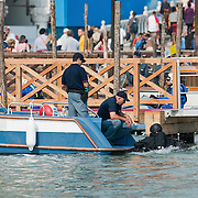 VENICE, ITALY - MAY 08:  Police divers performs underwater security checks to the gondola due to carry pope Benedict XVI in St Mark's  basin on May 8, 2011 in Venice, Italy. Pope Benedict XVI is visiting Venice, some 26 years after predecessor Pope John Paul II last visited city.  (Photo by Marco Secchi/Getty Images)