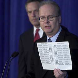 Austin, Texas 09NOV00:  Press Conference in Austin where Bush campaign chairman Don Evans and chief strategist Karl Rove (blue tie) discuss election results as ballot re-counting continues in Florida. Karl Rove with controversial ballot. © Bob Daemmrich