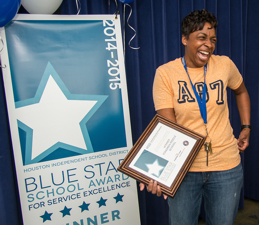 Fondren Middle School principal Monique Lewis reacts after being awarded the Blue Star School Award for Service Excellence, April 24, 2015.