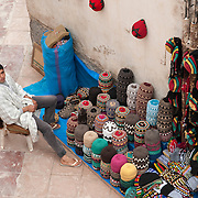 Man selling hats in Essaouira, Morocco