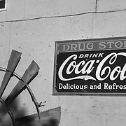 Coca Cola Drug Store Sign And Windmill Blades - Eldorado Canyon - Nelson NV - Black & White