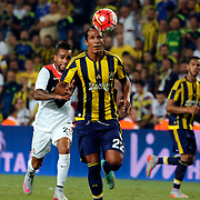 Fenerbahce's (M) Bruno Alves and Shakhtar Donetsk's (L) Alex Teixeira during their UEFA Champions league third qualifying round first leg soccer match Fenerbahce between Shakhtar Donetsk at the Sukru Saracaoglu stadium in Istanbul Turkey on Tuesday 28 July 2015. Photo by Aykut AKICI/TURKPIX