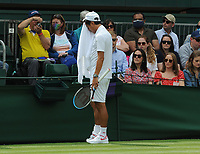 Tennis - 2021 All England Championship - Week One - Day Four (Thursday) - Wimbledon<br /> Kei Nishikori v Jordan Thompson<br /> <br /> A dejected Kei Nishikori of Japan watched by the fans<br /> <br /> CreditCOLORSPORT/Andrew Cowie