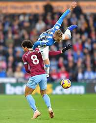 West Ham United's Felipe Anderson (left) and Huddersfield Town's Florent Hadergjonaj battle for the ball during the Premier League match at the John Smith's Stadium, Huddersfield.