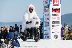 Roman Soldatov on his Abominable Snowman adorned BMW rnineT at the Baikal Mile Ice Speed Festival opening ceremonies where participants on the big stage were introduced to the crowd one at a time. Maksimiha, Siberia, Russia. Saturday, February 29, 2020. Photography ©2020 Michael Lichter.