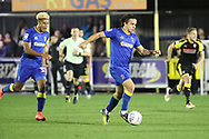 AFC Wimbledon attacker Egli Kaja (21) dribbling with AFC Wimbledon striker Lyle Taylor (33) shouting in the background during the EFL Sky Bet League 1 match between AFC Wimbledon and Rotherham United at the Cherry Red Records Stadium, Kingston, England on 17 October 2017. Photo by Matthew Redman.