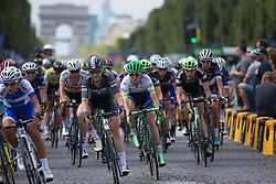 The peloton reaches the Place de Concorde for the penultimate time during the La Course, a 89 km road race in Paris on July 24, 2016 in France.