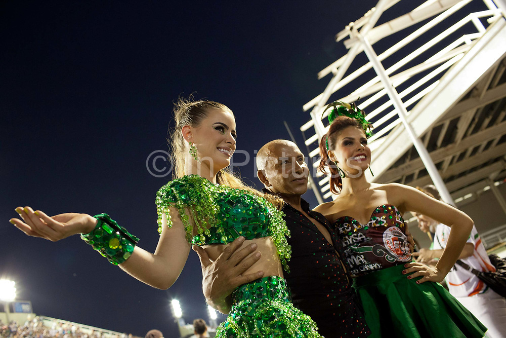 Barbara Evans and Paloma Bernardi posing for photos before her final practice performance, Grande Rio Samba School from the Special Group, practices their Carnival procession in the Sambadrome, Rio de Janeiro, Brazil
