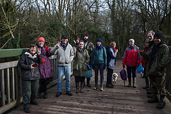 Denham, UK. 3 February, 2020. Environmental activists from Save Colne Valley and Extinction Rebellion celebrate after preventing works for the HS2 high-speed rail link for a day by occupying a bridge over the river Colne in Denham Country Park. Works believed to have been scheduled include the felling of 200 trees and the construction of a Bailey bridge, compounds, fencing and a parking area. One side of the river bank lies within a wetland nature reserve forming part of a Site of Metropolitan Importance for Nature Conservation (SMI).