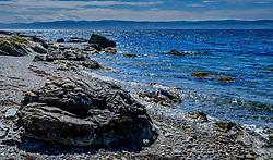 Seascape on the west coast of Arran, Scotland looking towards the Mull of Kintyre<br /> <br /> (c) Andrew Wilson   Edinburgh Elite media