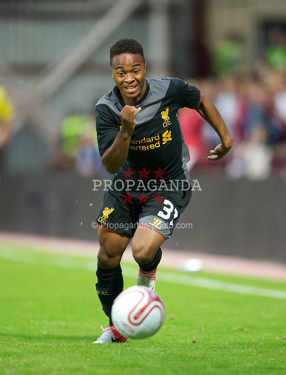 EDINBURGH, SCOTLAND - Thursday, August 23, 2012: Liverpool's Raheem Sterling in action against Heart of Midlothian during the UEFA Europa League Play-Off Round 1st Leg match at Tynecastle. (Pic by David Rawcliffe/Propaganda)