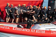 Emirates Team New Zealand helmsman Peter Burling sprays champagne on board after winning the America's Cup against Luna Rossa Prada Pirelli Team 7 - 3.  Wednesday the 17th of March 2021. Copyright photo: Chris Cameron