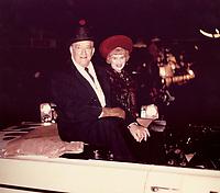 1964 Francis X. Bushman and wife at the Christmas Santa Claus Lane Parade on Hollywood Blvd.