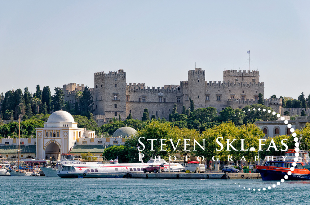 Rhodes. Greece. View from the harbour of the Palace of the Grand Masters which dominates the Rhodes town skyline. The island of Rhodes is the largest of the Dodecanese Island group and one of the most popular Greek Islands.