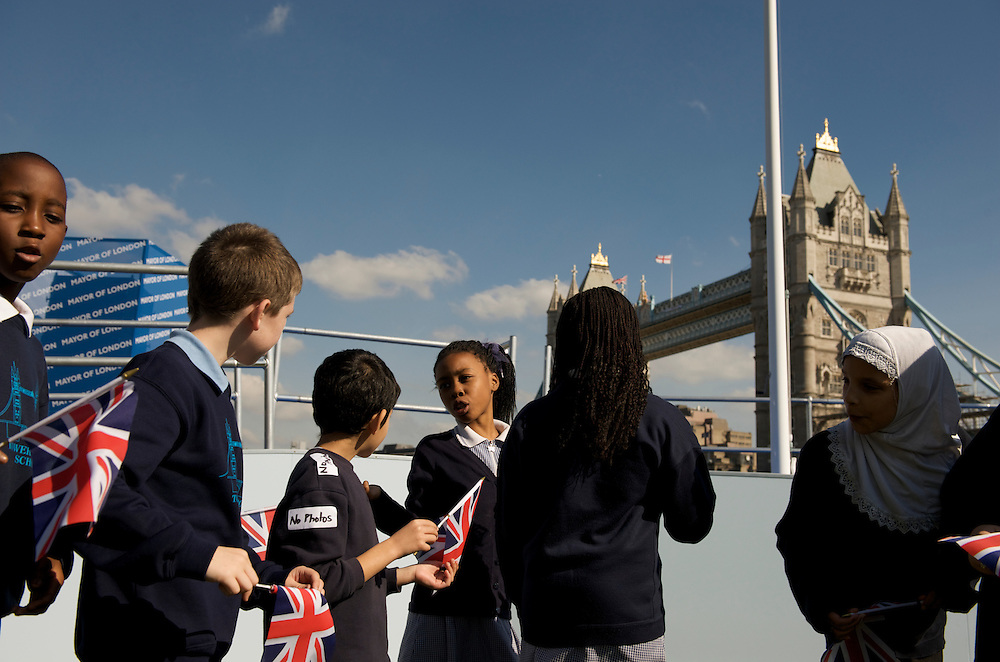 London.  September 26, 2008.  Children wave Union Jack flags prior to the Olympic flag handover ceremony for the 2012 games at Potter Fields Park.  London Mayor Boris Johnson, Olympic Minister Tessa Jowell MP, Lord Sebastian Coe, 400m gold medal winner Christine Ohuruogu, 1948 Olympians, and 2012 hopefuls also in attendance.  (Photo by Mark Bryan Makela)