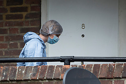 © licensed to London News Pictures. London, UK 30/07/2013. Forensic officers investigating the flat where a 29-year-old woman found dead and a 17-year-old with stab wounds at Tilson Gardens, Brixton. A 40-year-old man has been arrested on suspicion of murder after two women and a teenager were stabbed in south London. Photo credit: Tolga Akmen/LNP