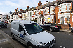 A forensics van is parked outside the victorian terrace where a 'small, contained' fire in an upstairs flat in Burnfoot Avenue, Fulham, claimed the life of a woman. Fulham, London. February 07 2018.