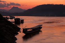 Laos, Luang Prabang, boats on Mekong River at sunset