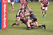 Sam Powell (9) of Wigan Warriors scores a try making it 6-6