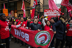 London, UK. 19 November, 2019. IWGB President Henry Chango Lopez (with microphone) accompanies UCL cleaners, porters and security officers outsourced via Axis and Sodexo and belonging to the trade union beginning a strike to end outsourcing and zero hour contracts. The strike is expected to be the largest ever strike of outsourced workers in UK higher education.