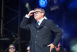"""Madness plays the main stage. Sunday, Rockness 2013, the annual music festival which took place in Scotland at Clune Farm, Dores, on the banks of Loch Ness, near Inverness in the Scottish Highlands. The festival is known as """"the most beautiful festival in the world""""."""