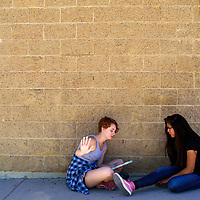 Coleen Blunt, left, and Mya Belen rehearse a song during the Young Americans summer camp at Crownpoint High School May 25.