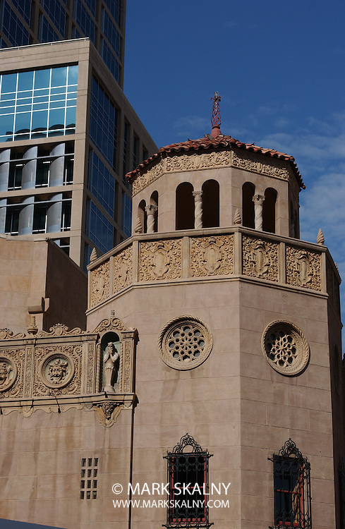 Downtown shot showing part of the Orpheum Theatre in Phoenix, Arizona against the day's blue sky.