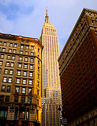 late nineteenth or early twentieth century apartments and offices, are sitting below the soaring Empire State Building, New York City