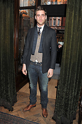 OLIVER JACKSON-COHEN at a reception hosted by Ralph Lauren Double RL and Dexter Fletcher before a private screening of Wild Bill benefitting FilmAid held at RRL 16 Mount Street, London on 26th March 2012.
