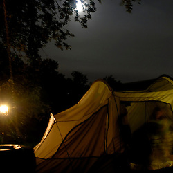 The kids prepare for bed in the tent they share during the Great American Backyard Campout held in the Ammar family farm on the banks of the Potomac River in Bryan's Road, Maryland...Photo by Susana Raab..