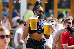 © Licensed to London News Pictures. 13/06/2021. London, UK. A staff member with buckets of beer for fans at Skylight Rooftop, Tobacco Dock in London as they watch England's opening Euro 2020 game. Photo credit: Dinendra Haria/LNP