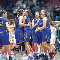 The Kirtland Central Broncos celebrate after a 46-42 victory over the St. Pius X Sartans in a District 5A quarterfinal at The Pit in Albuquerque Tuesday.