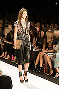 A black and beige pants outfit with lace accents and harness top at the BCBGMAXAZRIA show at the Spring 2013 Mercedes Benz Fashion Week in New York.