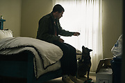 """BIRMINGHAM, AL – FEBRUARY 1, 2019:  Warren """"Azad"""" Stoddard, 24, rests at his girlfriend's apartment one week after returning from Syria, where he was injured fighting ISIS as a volunteer alongside Kurdish YPG forces. CREDIT: Bob Miller for The New York Times<br /> <br /> In the war against ISIS, American volunteers have joined the ranks of a Syrian militia, operating independently of the United States. Until recently, the predominantly Kurdish YPG forces had enjoyed air and ground support from the United States, but now that US is officially leaving, the remaining American volunteers face uncertain odds. <br /> <br /> Warren Stoddard, 24, comes from a long line of military veterans and active service members. So when a knee injury prevented him from enlisting in the Marines in 2016, he reached out to a YPG liaison on Facebook to declare his interest in volunteering. """"I always wanted to serve, to do something worthwhile and to take part in some historical event,"""" Stoddard said. """"And I cared about the Kurdish cause."""" Two years later, as the Turkish invasion placed added pressure on the predominantly Kurdish YPG, Stoddard finally received an invitation to join and purchased his own one way ticket. Six months later, while engaging an ISIS stronghold alongside his YPG unit, Stoddard caught bullet fragments in his his upper thigh and foot, where a small fragment is still lodged."""