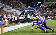 Seattle's Trevone Boykin (2) makes a dive into the endzone over Minnesota's Jayron Kearse to score a 2-point conversion in the fourth quarter of the Seahawks vs. Vikings pre-season game at CenturyLink Field, Thursday, Aug. 18, 2016.  (Genna Martin, seattlepi.com)