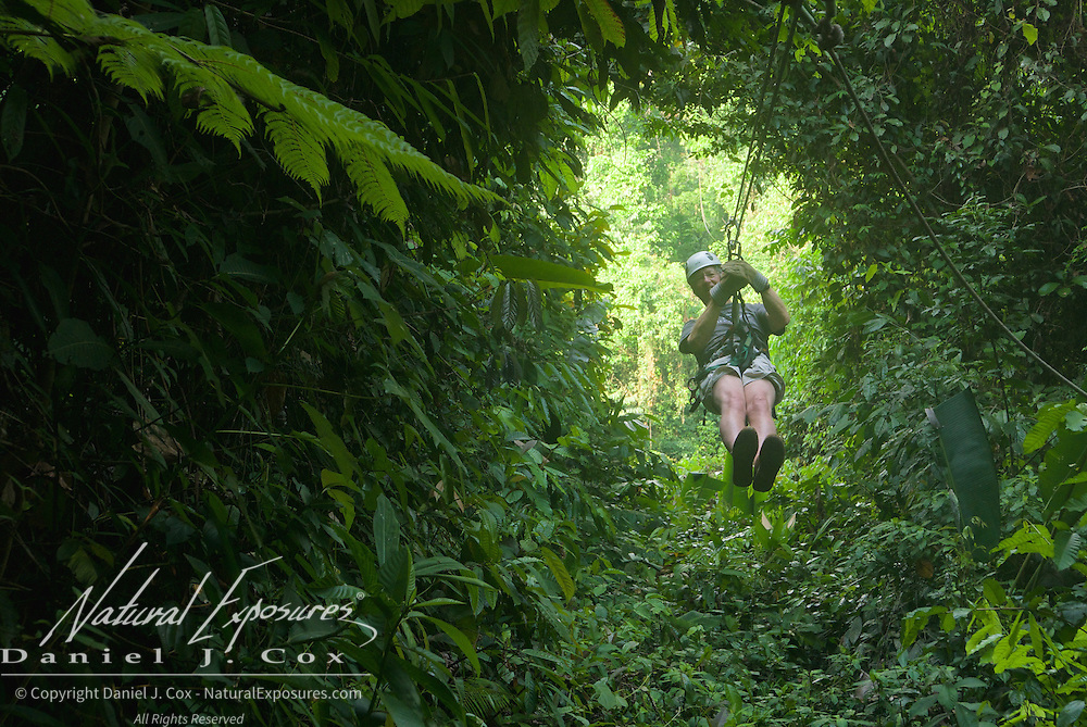 Tom coming through a gap in the forest canopy on the zip line. Costa Rica.