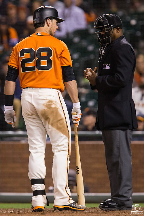 San Francisco Giants catcher Buster Posey (28) chats with umpire Alan Porter (64) after striking out in the ninth inning against the Baltimore Orioles at AT&T Park in San Francisco, Calif., on August 12, 2016. (Stan Olszewski/Special to S.F. Examiner)