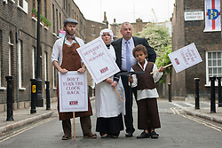 © licensed to London News Pictures. London, UK 31/05/2012. TUC General Secretary Brendan Barber (right) posing with people look like Victorian workers as TUC launches employment rights campaign today in London (31/05/12). Photo credit: Tolga Akmen/LNP