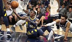 October 24, 2017 - Minneapolis, MN, USA - The Indiana Pacers' Darren Collison (2) passes the ball to a teammate as the Minnesota Timberwolves' Tyus Jones, right, reaches in during the second half at Target Center in Minneapolis on Tuesday, Oct. 24, 2017. The Pacers won, 130-107. (Credit Image: © Jerry Holt/TNS via ZUMA Wire)