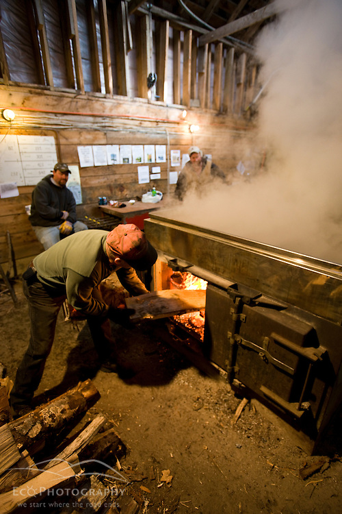 Bernie Braley stoking the fire in the sap evaporator in the sugar house  at Sugarbush Farm in Woodstock, Vermont.