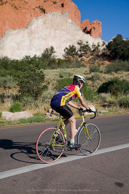 A road biker hits the cycling loop in Garden of the Gods, Colorado Springs, Colorado