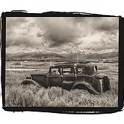 A rusting old jalopy sits in a field near Harrison, Montana.