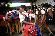 A child is leaving classes after a day spent a school run by Sonrisas de Bombay, a fast-growing Spanish NGO in Mumbai, India.