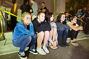"24 NOVEMBER 2011 - PHOENIX, AZ: L to R: Brit Reid (CQ) 15, Sydney Salazar (CQ) 15, Citlaly Morris (CQ), 17, Nicole Nardecchia (CQ), 16 and Alex Benton, (CQ), 16, all from Phoenix, watch the Harry Potter movie in the parking lot at the Best Buy store on Thunderbird and I 17 in Phoenix. ""Black Friday,"" the unofficial start of the holiday shopping season started even earlier than normal. Many stores, including Target and Best Buy, opened at midnight. The Best Buy at Thunderbird and I 17 showed a Harry Potter movie on the side of a rented truck in the parking lot to keep people amused while they waited for the store to open.   Photo by Jack Kurtz"